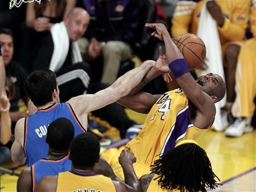 Los Angeles Lakers' Kobe Bryant, right, is fouled by Oklahoma City Thunder's Nick Collison during the first half in Game 4 of an NBA basketball playoffs Western Conference semifinal in Los Angeles, Saturday, May 19, 2012. (AP Photo/Jae C. Hong)