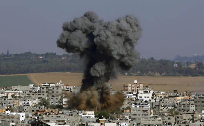 FILE - In this May 11, 2021, file photo, smoke rises after an Israeli airstrike in Gaza City. Israel is at war with Hamas, Jewish-Arab mob violence has erupted inside Israel, and the West Bank is experiencing its deadliest unrest in years. Yet this may all bolster Prime Minister Benjamin Netanyahu. (AP Photo/Hatem Moussa, File)