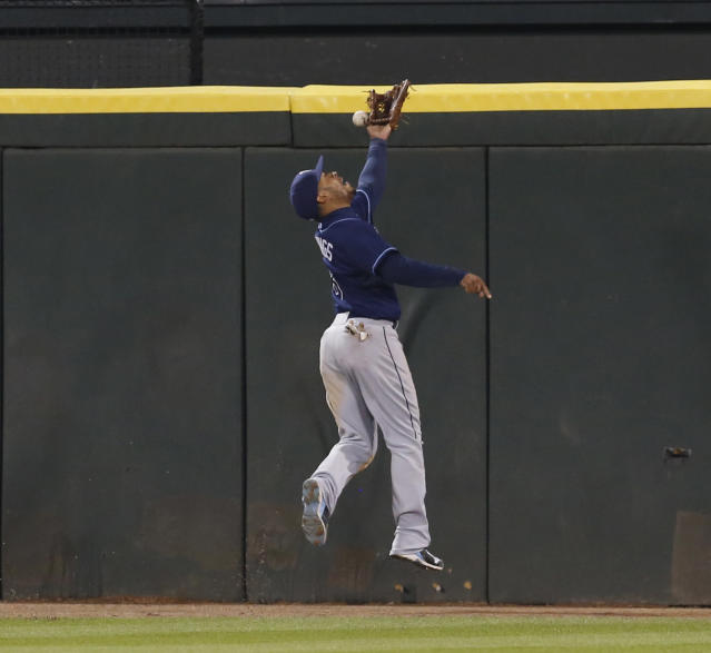 Tampa Bay Rays center fielder Desmond Jennings (8) is unable to catch an RBI triple by Chicago White Sox's Alexei Ramirez, scoring Dayan Viciedo, during the fourth inning of a baseball game Monday, April 28, 2014, in Chicago. (AP Photo/Charles Rex Arbogast)