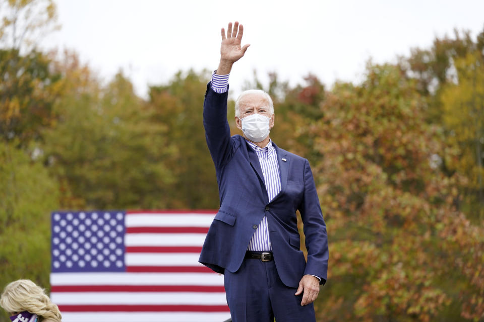 Democratic presidential candidate former Vice President Joe Biden waves during a campaign stop at Bucks County Community College, Saturday, Oct. 24, 2020, in Bristol, Pa. (AP Photo/Andrew Harnik)