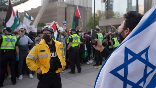 A pro-Israel supporter chants at pro-Palestinians supporters during a demonstration against the current violence in Gaza in Toronto on Saturday, May 15, 2021.