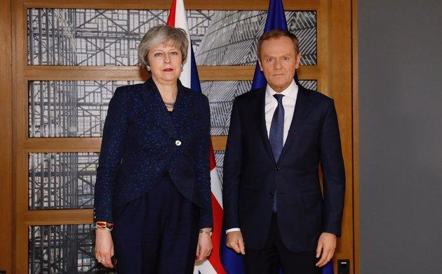 An unsmiling Theresa May with EU council president Donald Tusk