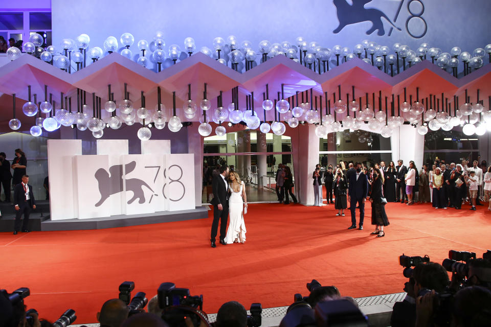 FILE - In this Sept, 10, 2021 file photo Jennifer Lopez, centre right, and Ben Affleck pose for photographers upon arrival at the premiere of the film 'The Last Duel' during the 78th edition of the Venice Film Festival in Venice, Italy. (Photo by Joel C Ryan/Invision/AP, File)