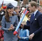 <p>Here she is in the collarless coat laughing at Will as he holds a toy rocket in Nottingham, England, during the Diamond Jubilee tour. </p>