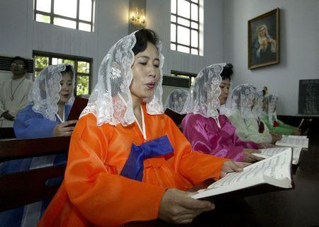 File photo of North Koreans reading mass at a Catholic church in Pyongyang