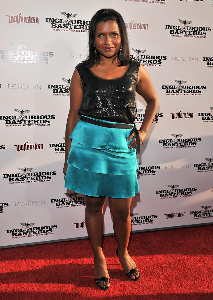 """HOLLYWOOD - AUGUST 10:  Actress Mindy Kaling arrives on the red carpet of the Los Angeles premiere of """"Inglorious Basterds"""" at the Grauman's Chinese Theatre on August 10, 2009 in Hollywood, California.  (Photo by Lester Cohen/WireImage)"""
