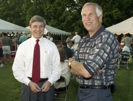Penn State University President Graham Spanier (L) and Second Mile founder and Penn State assistant football coach Jerry Sandusky, attend the Second Mile Celebrity Golf Classic, in State College, Pennsylvania, in this 1997 file photo. REUTERS/Craig Houtz/Files