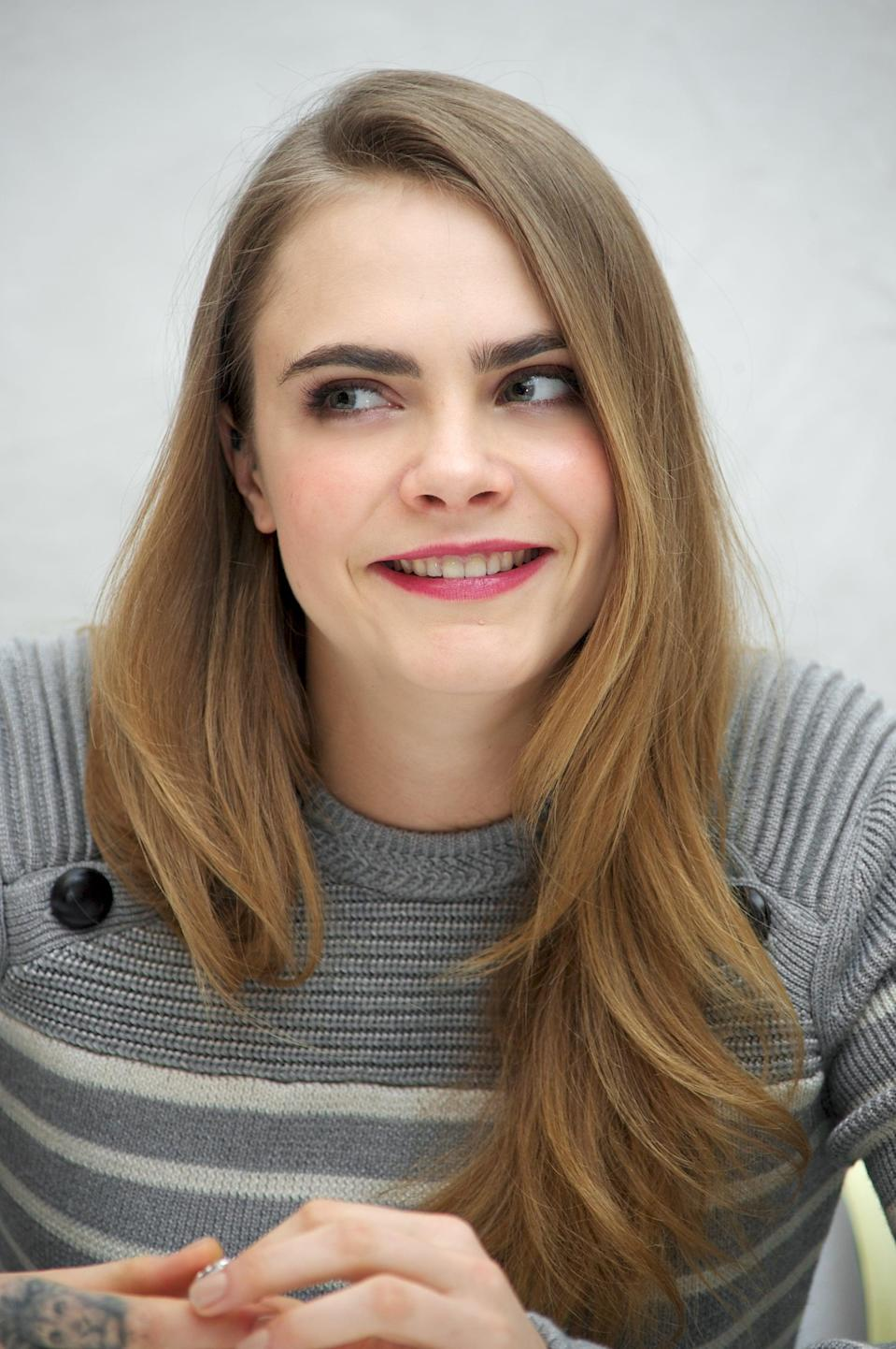 <p>The smooth, simple blowout Delevingne wore at a <strong>Paper Towns</strong> Press Conference in 2015 showed off her long, fluid layers as well as her gorgeous ash-blond hue, which is probably the closest to the model/actor's natural hair color as we're every going to see.</p>