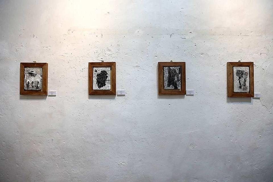 Some of Alaa's paintings with their bold abstract black strokes seen at China House in George Town October 23, 2019. — Picture by Sayuti Zainudin