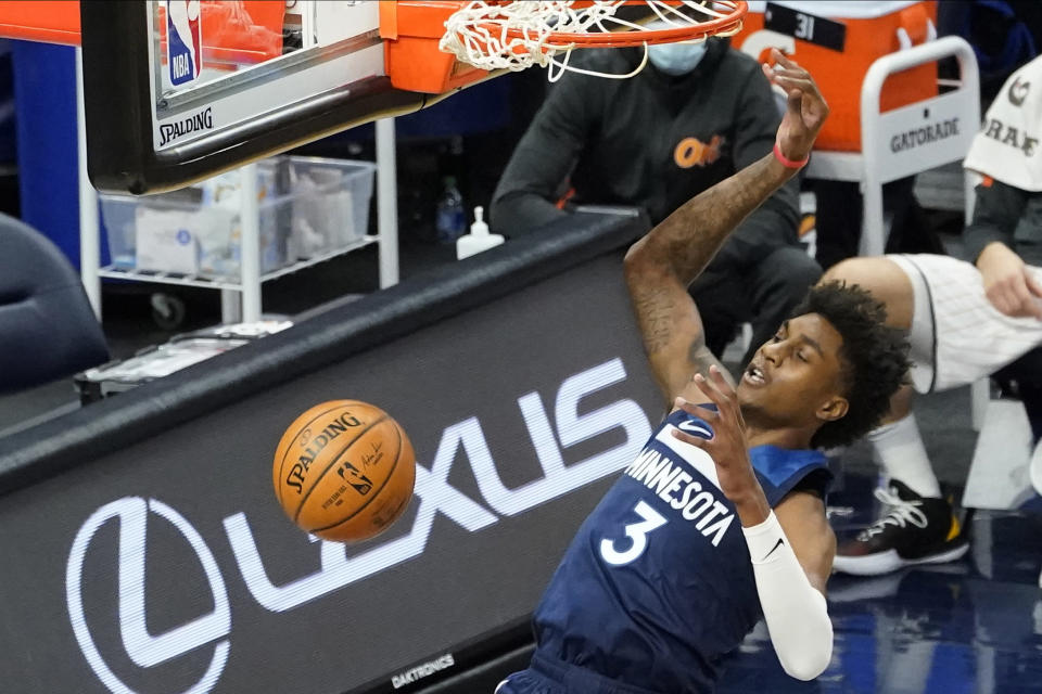 Minnesota Timberwolves' Jaden McDaniels dunks against the Orlando Magic during the first half of an NBA basketball game Wednesday, Jan. 20, 2021, in Minneapolis. (AP Photo/Jim Mone)