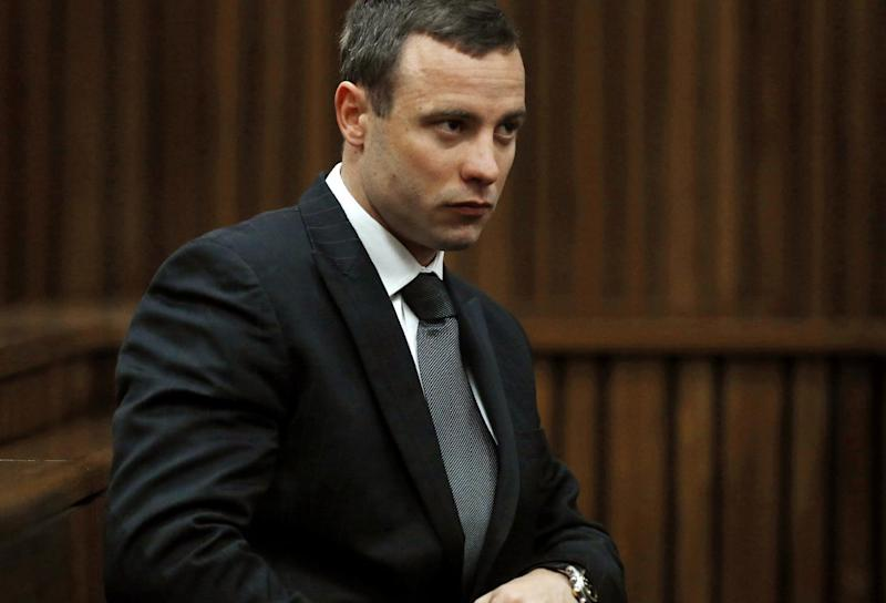 A file picture taken on July 1, 2014 shows South African Olympic and Paralympic sprinter Oscar Pistorius sitting in the dock during his murder trial in the North Gauteng High Court in Pretoria