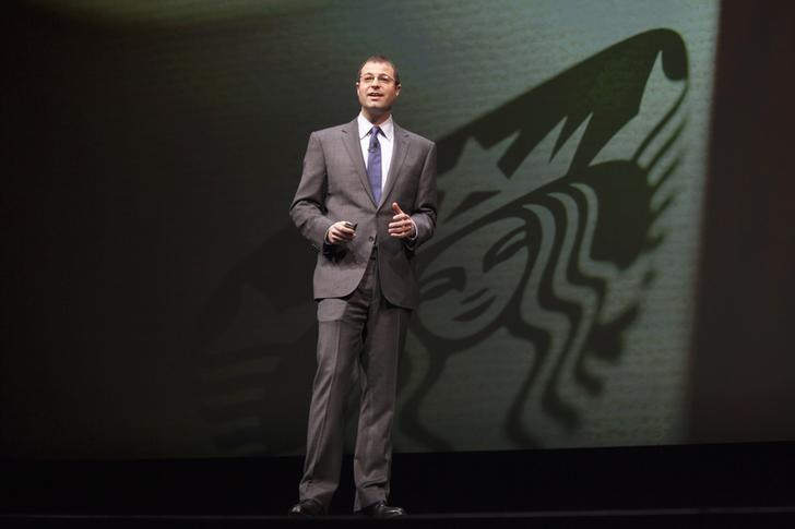 Adam Brotman, is pictured on stage during the company's annual shareholders meeting in Seattle