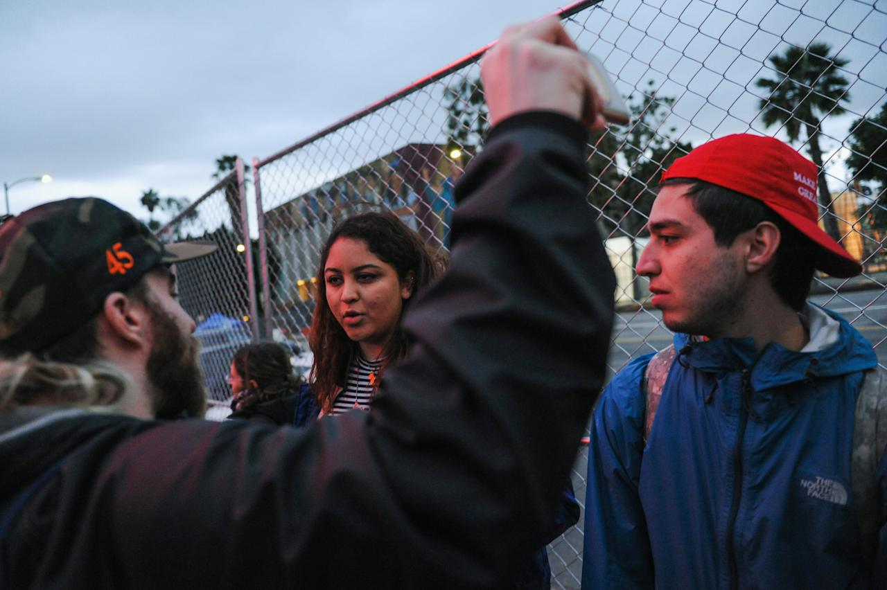 Tim Treadstone, left, a Trump supporter and social media strategist known by the name Baked Alaska, films Nazmun Nahar, a student at the University of Michigan who came to Los Angeles with friends for spring break, as they argue outside the Oscar ceremony in Hollywood, California, U.S. February 26, 2017. REUTERS/Andrew Cullen