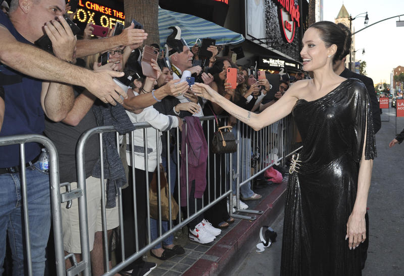 "Angelina Jolie signs autographs as she arrives at the world premiere of ""Maleficent: Mistress of Evil"" on Monday, Sept. 30, 2019, at the El Capitan Theatre in Los Angeles. (Photo by Richard Shotwell/Invision/AP)"