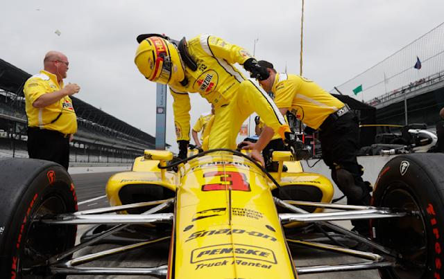Helio Castroneves, of Brazil, climbs into his car during a practice session for the IndyCar Indianapolis 500 auto race at Indianapolis Motor Speedway, in Indianapolis Monday, May 21, 2018. (AP Photo/Michael Conroy)