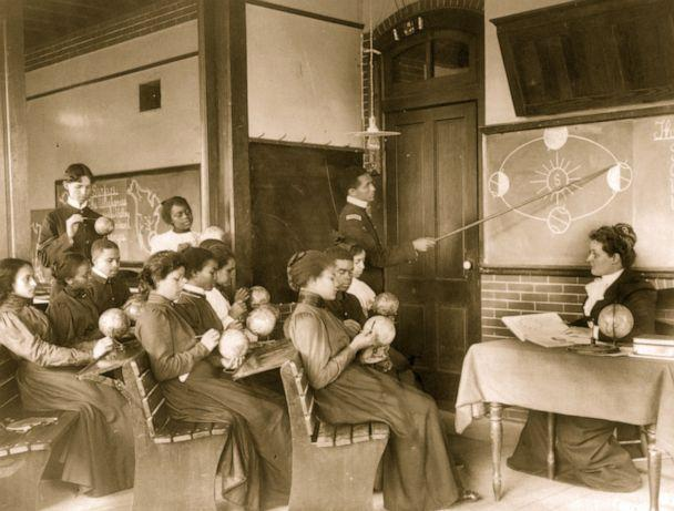 PHOTO: Students in a mathematical geography class study the earth's rotation around the sun, at the Hampton Institute, Hampton, Va., circa. 1899. (Getty Images)