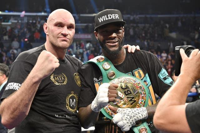 Tyson Fury, left, and Deontay Wilder will fight for a third time next month (Lionel Hahn/PA)