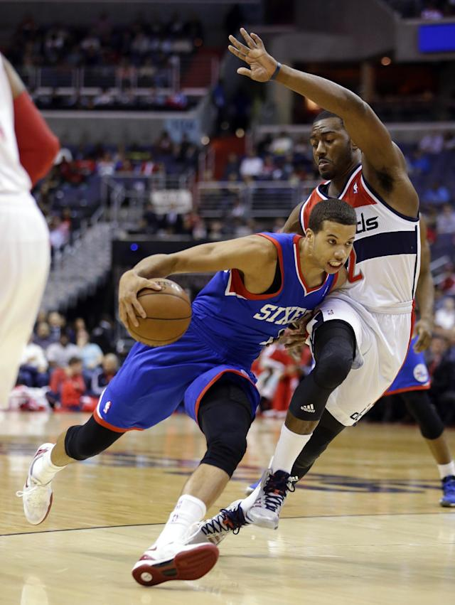 Philadelphia 76ers guard Michael Carter-Williams (1) drives against Washington Wizards guard John Wall (2) in the first half of an NBA basketball game, Friday, Nov. 1, 2013, in Washington. (AP Photo/Alex Brandon)