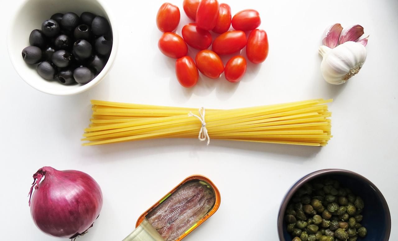 <p><em>Spaghetti alla puttanesca</em>, first became popular in the 1960's as has remained a staple ever since. The sauce can be kept in the fridge or even frozen for pasta emergencies! Update the dish by using linguine instead of the classic spaghetti.<br />You will need linguine, baby plum tomatoes, black olives, anchovies, capers, a clove of garlic and half a red onion. </p>