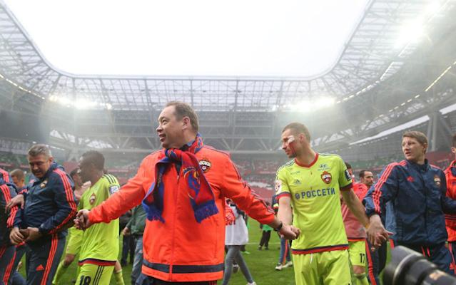 <span>Slutsky and the CSKA Moscow players celebrate winning the Russian Premier League last May</span> <span>Credit: Getty images </span>