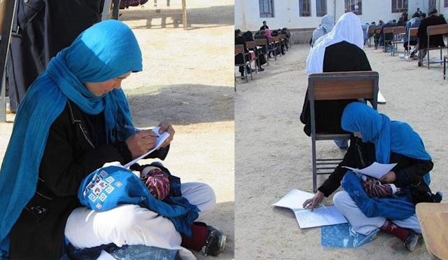 A 25-year-old mother of three cares for her 2-month-old baby during a college entrance exam. (Photo: Yahya Erfan)