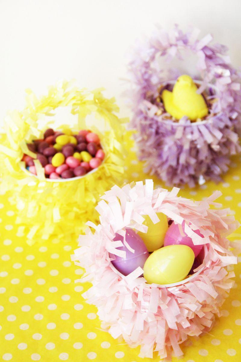 """<p>These tiny baskets, which are made from plastic cups, also make cute place card holders for Easter brunch or dinner. </p><p><em><a href=""""http://studiodiy.com/2012/03/27/diy-mini-easter-baskets/"""" rel=""""nofollow noopener"""" target=""""_blank"""" data-ylk=""""slk:Get the tutorial from Studio DIY »"""" class=""""link rapid-noclick-resp"""">Get the tutorial from Studio DIY »</a></em> </p>"""