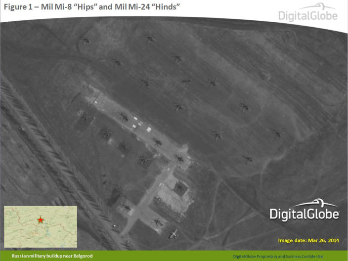"""This satellite image made by DigitalGlobe on March 26, 2014, and provided by Supreme Headquarters Allied Powers Europe (SHAPE) on Tuesday, April 9, 2014, shows what are purported to be Russian Mil Mi-8 """"Hips"""" and Mil Mi-24 """"Hinds"""" aircraft in Belgorod, southern Russia, about 50 km north of the Russian border with eastern Ukraine. The image is one of several provided to the AP by NATO's headquarters that show dozens of Russian tanks and other armored vehicles, combat jets and helicopter gunships stationed inside Russian territory near to the eastern border with Ukraine. AP cannot independently verify the authenticity or content of this image. (AP Photo/DigitalGlobe via SHAPE) MANDATORY CREDIT, NO CROPPING OR MODIFICATIONS ALLOWED"""