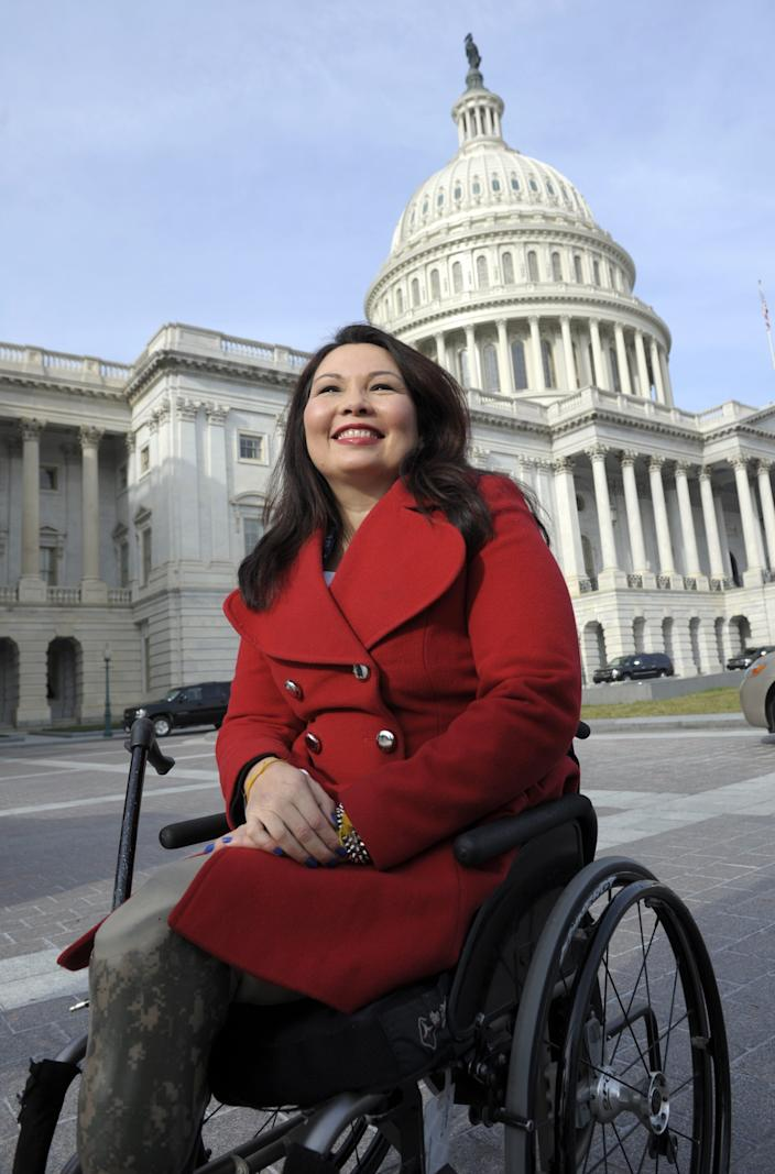 Rep. Tammy Duckworth, D-Ill. is seen on Capitol Hill in Washington, Thursday, Jan. 3, 2013, as she poses with other female House members prior to the official opening of the 113th Congress.