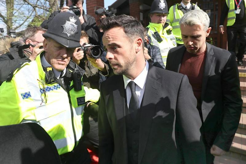 Charged: Ant McPartlin leaves court (Steve Parsons/PA )