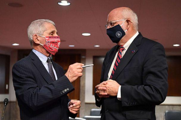 PHOTO: Dr. Anthony Fauci and Dr. Robert Redfield talk prior to the Senate Health, Education, Labor and Pensions (HELP) Committee hearing on Capitol Hill in Washington DC on June 30, 2020. (Kevin Dietsch/POOL/AFP via Getty Images)