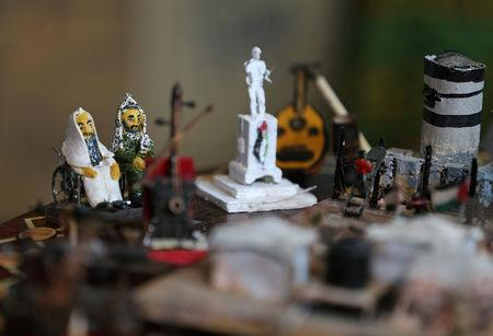 Miniature figures carved by Palestinian diorama artist Majdi Abu Taqeya using remnants of Israeli ammunition collected from the scenes of border protests along the Israel-Gaza border are seen in the central Gaza Strip March 11, 2019. Picture taken March 11, 2019. REUTERS/Ibraheem Abu Mustafa