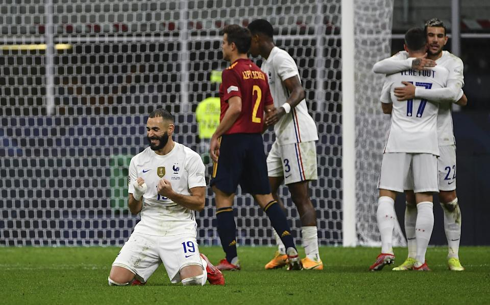 MILAN, ITALY, OCTOBER 10: Karim Benzema (L), of France, celebrates at the end of the UEFA Nations League football tournament final match between Spain and France at San Siro stadium in Milan, Italy, on October 10, 2021. France defeated Spain 2-1. (Photo by Isabella Bonotto/Anadolu Agency via Getty Images)
