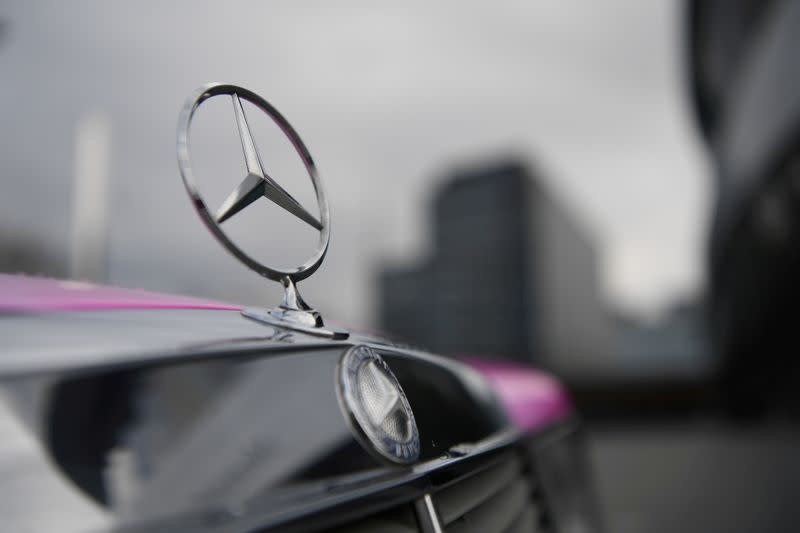 FILE PHOTO: The Mercedes-Benz logo is seen on a car in front of the Mercedes-Benz Museum in Stuttgart