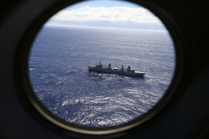 <p> FILE - In this March 31, 2014 file photo, HMAS Success scans the southern Indian Ocean, near the coast of Western Australia, as a Royal New Zealand Air Force P3 Orion flies over, while searching for missing Malaysia Airlines Flight MH370. After nearly three years, the hunt for Malaysia Airlines Flight 370 ended in futility and frustration on Tuesday, Jan. 17, 2017, as crews completed their deep-sea search of a desolate stretch of the Indian Ocean without finding a single trace of the plane. (AP Photo/Rob Griffith, File) </p>