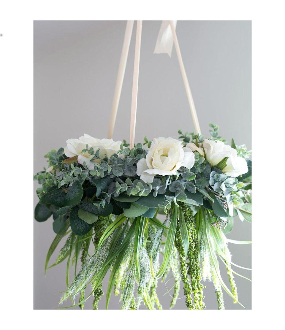 """<p>The loveliest thing about this floral chandelier is that it can be reused for weddings, birthdays, or any other special occasions.</p><p><em><a href=""""https://www.afloral.com/blogs/how-to-diy/diy-chandelier-with-artificial-flowers?utm_medium=Social&utm_source=Pinterest"""" rel=""""nofollow noopener"""" target=""""_blank"""" data-ylk=""""slk:Get the tutorial at AFLORAL »"""" class=""""link rapid-noclick-resp"""">Get the tutorial at AFLORAL »</a></em></p>"""