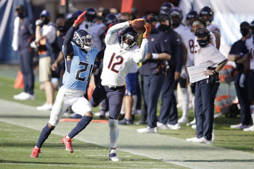 Chicago Bears wide receiver Allen Robinson (12) catches a pass as he is defended by Tennessee Titans cornerback Malcolm Butler (21) in the second half of an NFL football game Sunday, Nov. 8, 2020, in Nashville, Tenn. (AP Photo/Ben Margot)
