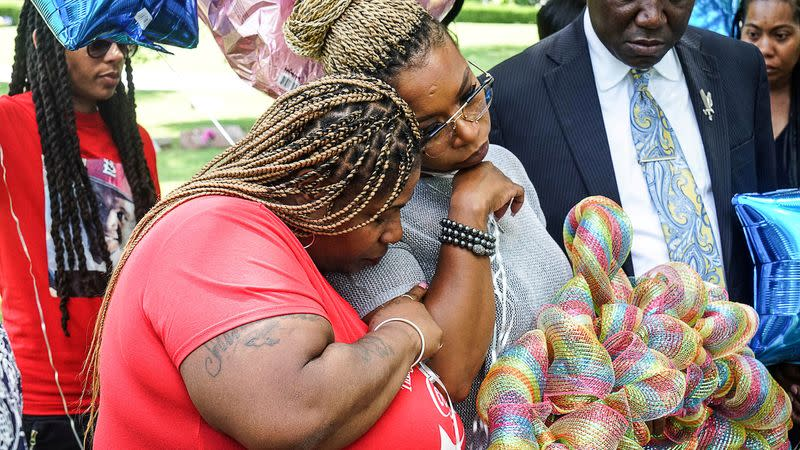 FILE PHOTO: Samaria Rice mother of Tamir Rice comforts Lezley McSpadden, mother of Michel Brown Jr., at his gravesite on the 5-year anniversary of his passing in Normandy