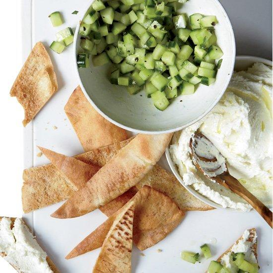 "<p>The taste of the Mediterranean shines through in this airy feta spread that's served with olive oil-marinated cucumbers.</p><p><a href=""https://www.foodandwine.com/recipes/whipped-feta-with-cucumbers"">GO TO RECIPE</a></p>"