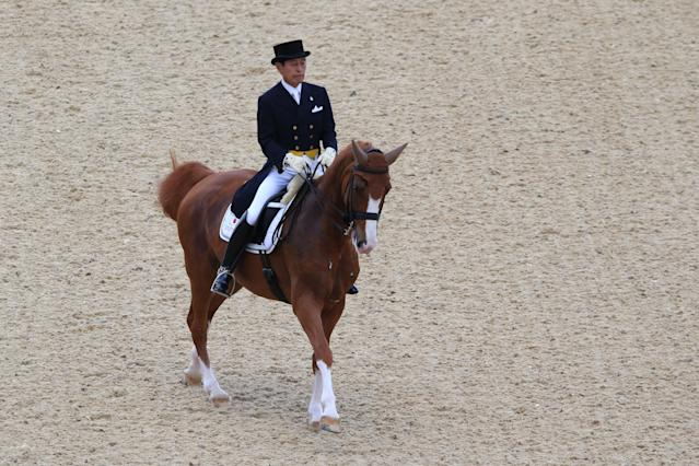 LONDON, ENGLAND - AUGUST 02: Hiroshi Hoketsu of Japan riding Whisper riding Grandioso competes in the Dressage Grand Prix on Day 6 of the London 2012 Olympic Games at Greenwich Park on August 2, 2012 in London, England. (Photo by Alex Livesey/Getty Images)