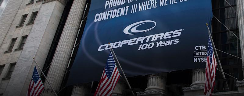 Banner hanging from exterior of NYSE featuring Cooper Tires.
