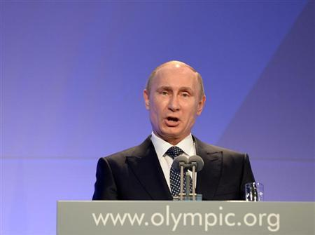 Russian President Vladimir Putin delivers his speech at the International Olympic Committee (IOC) Gala Dinner at the 2014 Sochi Winter Olympics, February 6, 2014. REUTERS/Andrej Isakovic/Pool