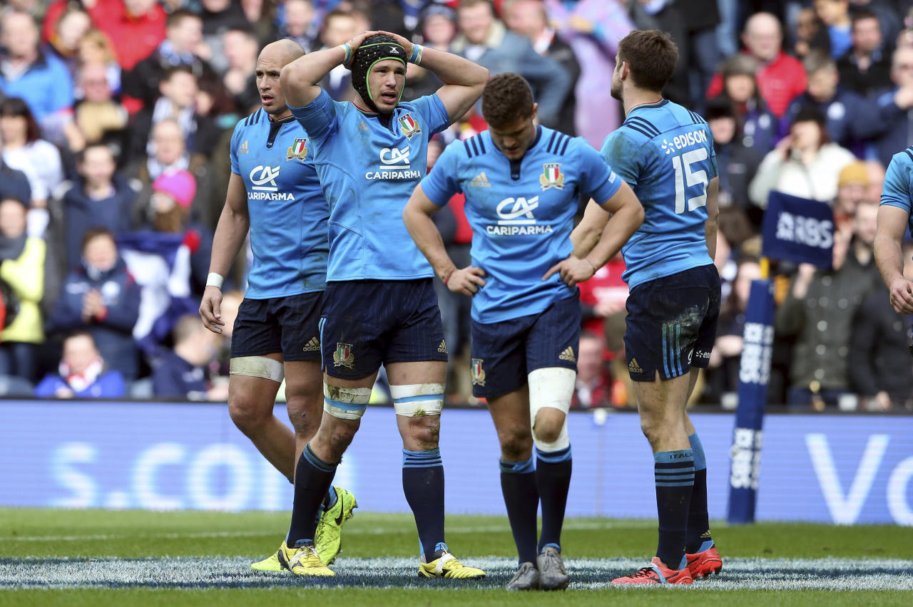 Italy's Francesco Minto, second left, stands dejected, during the Six Nations rugby union international match between Scotland and Italy at Murrayfield stadium, in Edinburgh, Scotland, Saturday, March 18, 2017. (AP Photo/Scott Heppell)