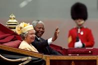 <p>Nelson Mandela, President of South Africa, rides alongside The Queen in a carriage along the Mall on the first day of his state visit to Britain. (PA Archive) </p>