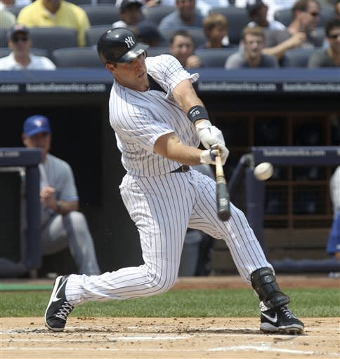 New York Yankees' Mark Teixeira hits a two-run homer during the first inning of a baseball game against the Toronto Blue Jays, Wednesday, July 18, 2012 at Yankee Stadium in New York. (AP Photo/Seth Wenig)