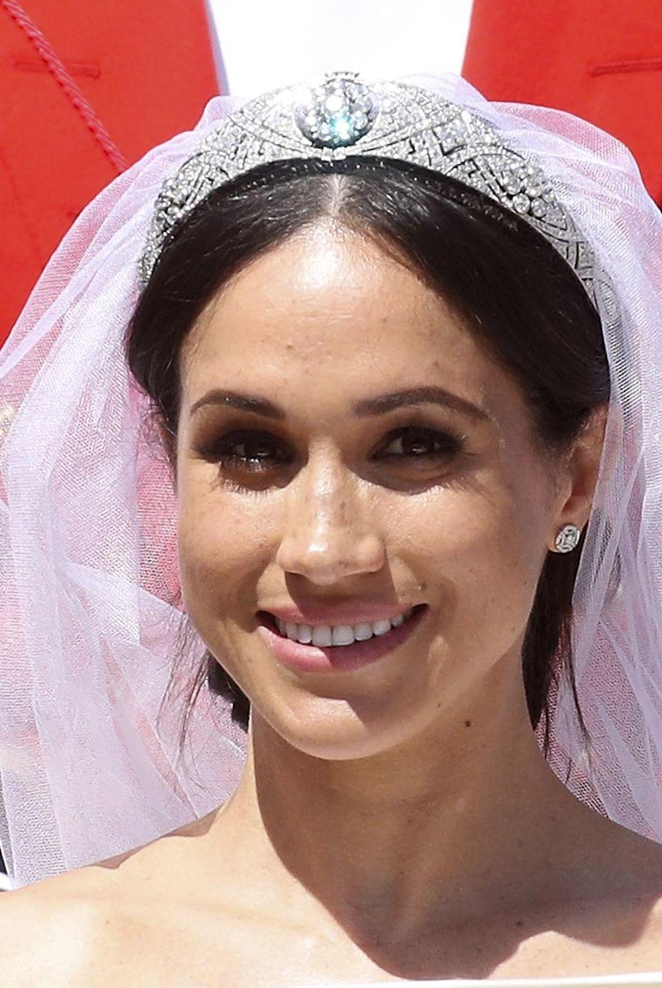 <p>The showstopping bandeau tiara worn by Meghan, Duchess of Sussex, on her wedding day was made by Garrard in 1925 for the Queen's grandmother, Queen Mary. It originally had a sapphire centerpiece, but it has since been changed to a diamond. It was loaned to Meghan by the Queen for her wedding day. The tiara was also worn by the late Princes Margaret, the Queen's sister.</p>