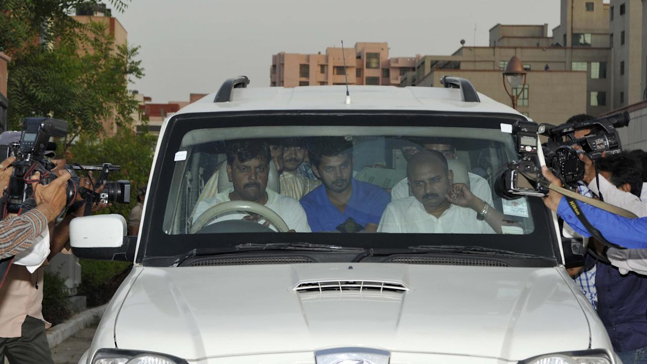 NEW DELHI, INDIA - MAY 21: Indian Cricketer Sreesanth along with the Special Cell Officials leave Saket Court on May 21, 2013 in New Delhi, India. Sreesanth was remanded in further five-day police custody by Metropolitan Magistrate. (Photo by Sonu Mehta/Hindustan Times via Getty Images)