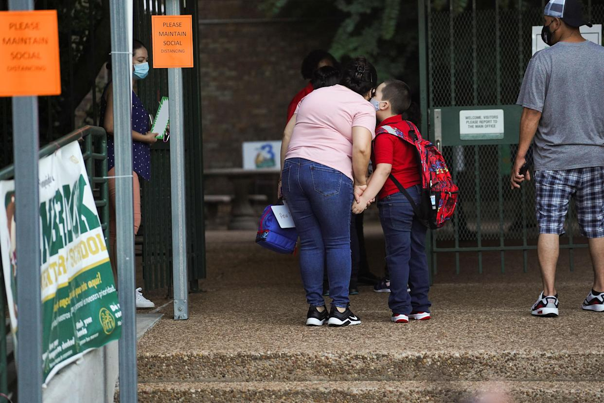 A student before entering Benbrook Elementary School in Houston on the first day of school on Aug. 23. (Reuters/Go Nakamura)