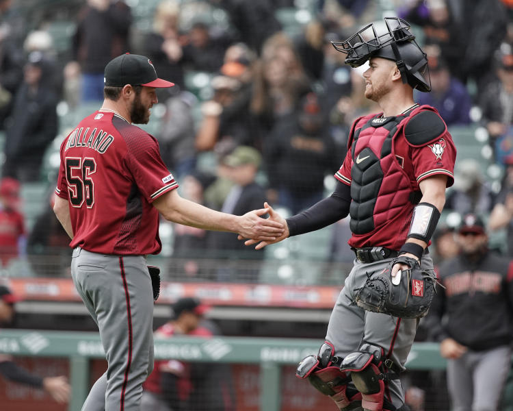 Arizona Diamondbacks pitcher Greg Holland (56) is congratulated by catcher Carson Kelly after a victory over the San Francisco Giants in a baseball game in San Francisco, Sunday, May 26, 2019. (AP Photo/Tony Avelar)