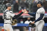 New York Yankees relief pitcher Aroldis Chapman, right, is congratulated by catcher Kyle Higashioka after they defeated the Cleveland Indians in a baseball game, Thursday, April 22, 2021, in Cleveland. (AP Photo/Tony Dejak)