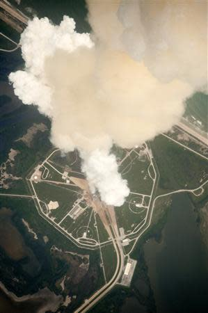 The exhaust plume from Space Shuttle Atlantis is seen through the window of a Shuttle Training Aircraft as it launches from pad 39A at the Kennedy Space Center in this NASA handout photo from July 8, 2011. REUTERS/NASA/Handout